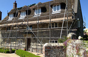 Image of Scaffolding for a Thatcher to renew thatched roof